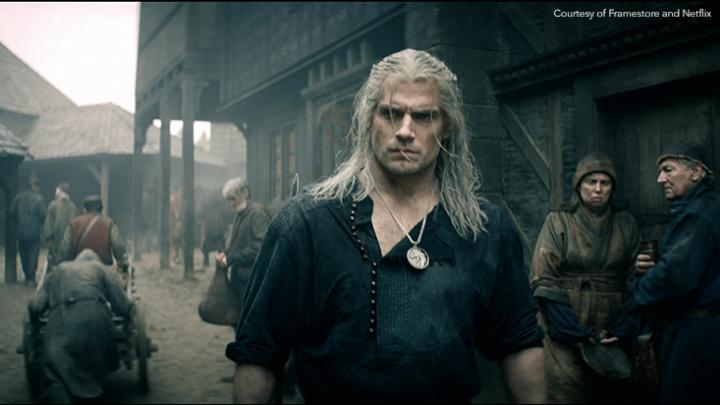 Henry Cavill as Geralt of Rivia walking through Blaviken